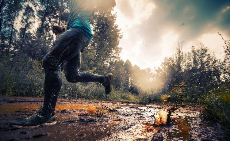 Running over muddy ground on a cross-country run.