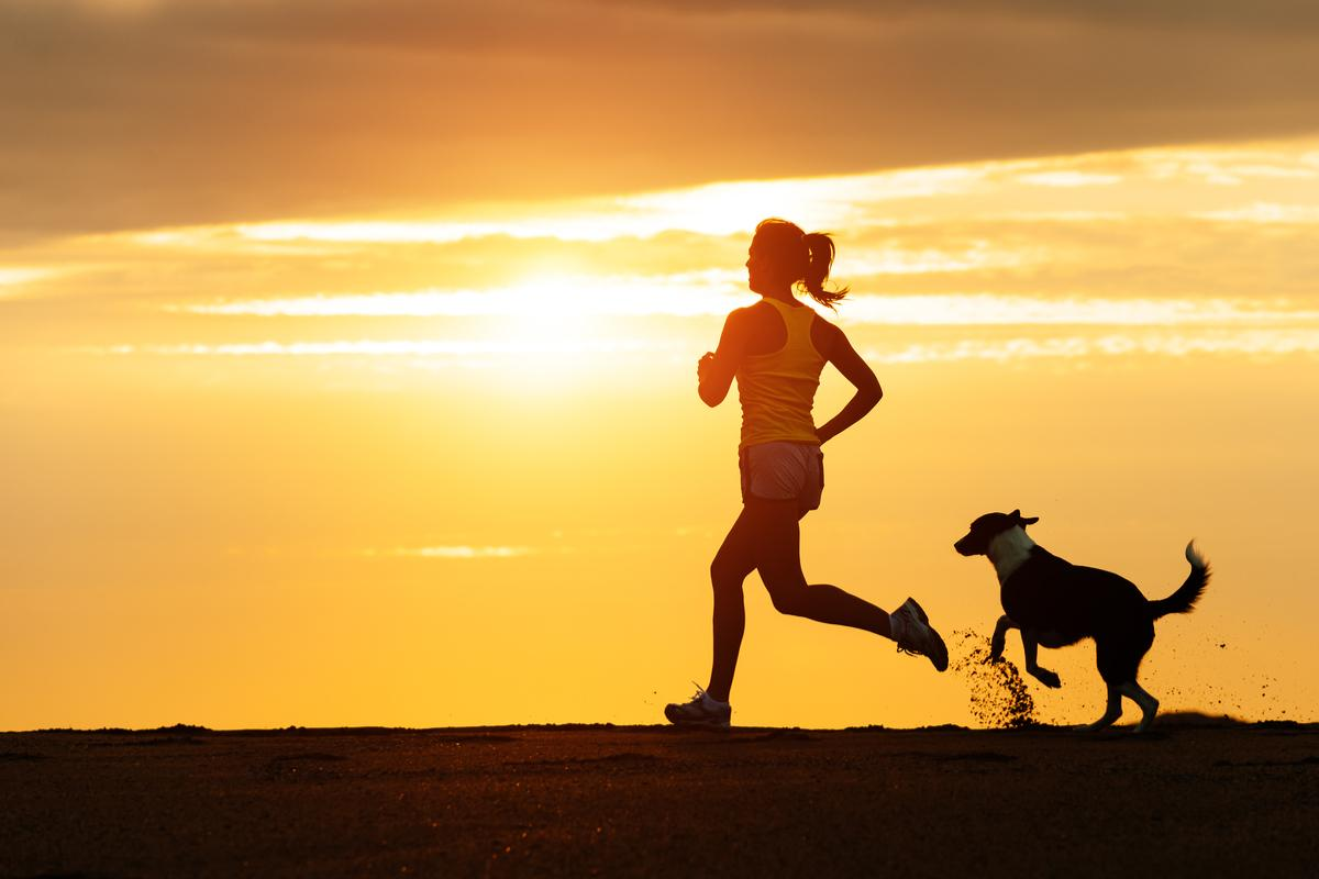 Running with her four-legged friend.